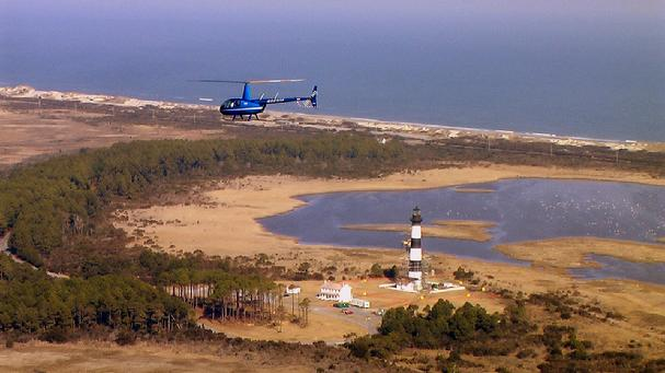 Coastal Helicopters R-44 flys past Bodie Island Light - Photo from CH web site