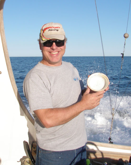 Diver Charlie Bulloss shows off the china bowl he recovered from the Manuela, DiveHatteras photo