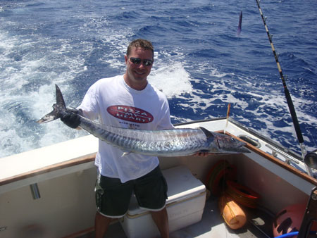 Diver Eric Koehler shows off a nice Wahoo that he got near the Proteus wreck site.   Photo courtesy Eric